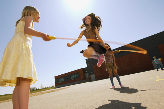 Schoolgirls jumping rope